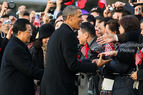 United States President Barack Obama (R) greets guests with President Hu Jintao of China during a State arrival ceremony on the South Lawn of the White House, Wednesday, January 19, 2011 in Washington, DC. Obama and Hu are scheduled to meet in the Oval Office later in the day, hold a joint press conference and attend a State dinner. .Credit: Mark Wilson / Pool via CNP