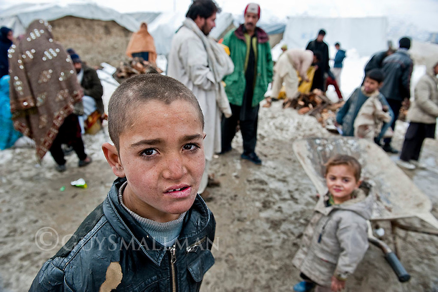 German NGO Welthungerhilfe adminster the delivery of free emergency fire wood to Afghan refugees in Kabul 15-1-12