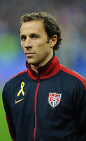 Steve Cherundolo of team USA stands for the national anthem prior to the friendly match France against USA at the Stade de France in Paris, France on November 11th, 2011.