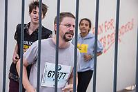 """Der Berliner Menschenrechtler Peter Steudtner laeuft am Sonntag den 16. September 2018 auf dem Potsdamer Platz in Berlin zeitgleich zum Berlin-Marathon den Marathon in einem symbolischen Nachbau eines tuerkischen Gefaengnishofes mit.<br /> Steudtner und Amnesty International nutzen mit Unterstuetzung der Veranstalter des Berlin-Marathons dieses sportliche Spitzenereignis, um auf die dramatische Situation von Menschenrechtsverteidigern weltweit aufmerksam zu machen. Hunderte befinden sich weltweit zu Unrecht in Haft, oftmals unter unmenschlichen Bedingungen und ohne Aussicht auf ein faires Verfahren. """"Menschenrechtsverteidiger sind ueberlebenswichtig. Ueberall. Fuer alle. Solidaritaet schuetzt sie und uns"""", sagt Steudtner.<br /> Im Bild: Unterstuetzer der Aktion laufen mit Peter Steudtner (vorne).<br /> 16.9.2018, Berlin<br /> Copyright: Christian-Ditsch.de<br /> [Inhaltsveraendernde Manipulation des Fotos nur nach ausdruecklicher Genehmigung des Fotografen. Vereinbarungen ueber Abtretung von Persoenlichkeitsrechten/Model Release der abgebildeten Person/Personen liegen nicht vor. NO MODEL RELEASE! Nur fuer Redaktionelle Zwecke. Don't publish without copyright Christian-Ditsch.de, Veroeffentlichung nur mit Fotografennennung, sowie gegen Honorar, MwSt. und Beleg. Konto: I N G - D i B a, IBAN DE58500105175400192269, BIC INGDDEFFXXX, Kontakt: post@christian-ditsch.de<br /> Bei der Bearbeitung der Dateiinformationen darf die Urheberkennzeichnung in den EXIF- und  IPTC-Daten nicht entfernt werden, diese sind in digitalen Medien nach §95c UrhG rechtlich geschuetzt. Der Urhebervermerk wird gemaess §13 UrhG verlangt.]"""