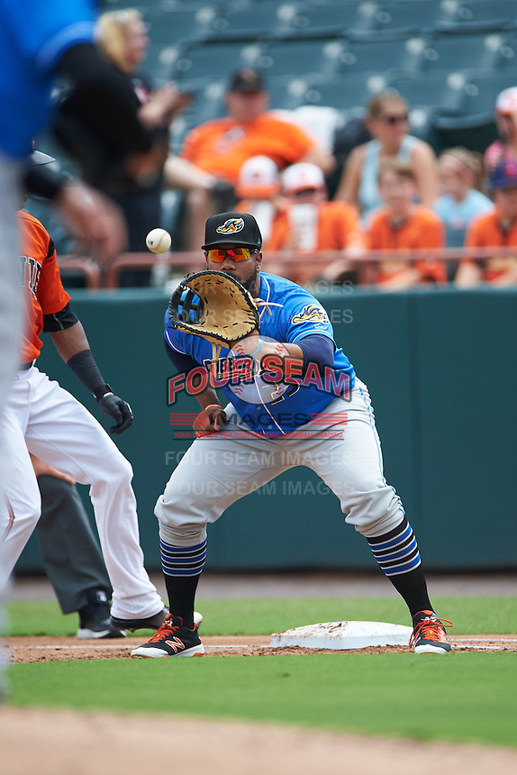 Akron RubberDucks first baseman Nellie Rodriguez (25) waits for a throw during the first game of a doubleheader against the Bowie Baysox on June 5, 2016 at Prince George's Stadium in Bowie, Maryland.  Bowie defeated Akron 6-0.  (Mike Janes/Four Seam Images)