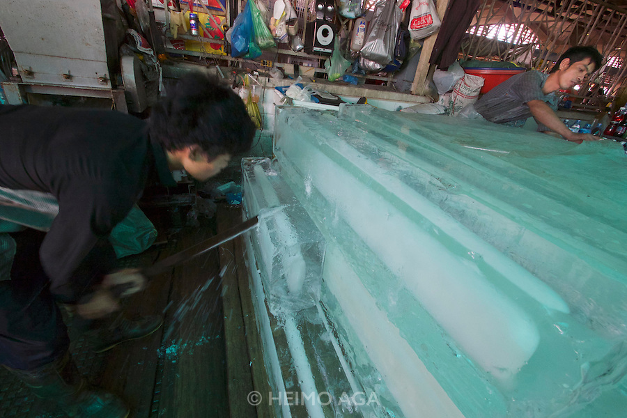 Phnom Penh, Cambodia. Central Market. Making crushed ice.