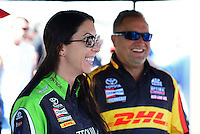 Sept. 28, 2012; Madison, IL, USA: NHRA funny car driver Alexis DeJoria (left) with teammate Jeff Arend during qualifying for the Midwest Nationals at Gateway Motorsports Park. Mandatory Credit: Mark J. Rebilas-