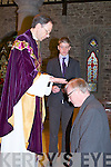BLESSING: Fr James Hurley after his First mass in ST John's Church Tralee gave his blessing to the congreggion and Pat Hickey with looking on was Sean Hurley7, on Saturday................... . ............................... ..........