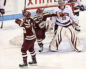 Ashley Motherwell (BC - 18), Emily Field (BC - 15), Chloe Desjardins (NU - 29) - The Northeastern University Huskies defeated Boston College Eagles 4-3 to repeat as Beanpot champions on Tuesday, February 12, 2013, at Matthews Arena in Boston, Massachusetts.