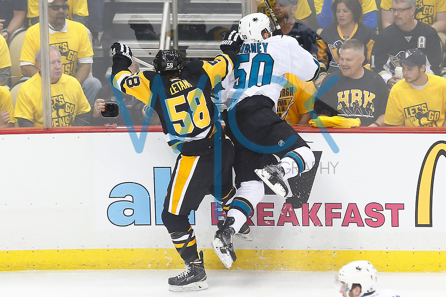 Kris Letang #58 of the Pittsburgh Penguins hits \Chris Tierney #50 of the San Jose Sharks in the first period during game one of the Stanley Cup Final at Consol Energy Center in Pittsburgh, Pennslyvania on May 30, 2016. (Photo by Jared Wickerham / DKPS)