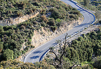 Stock image - Curvy motor-way on the rocky hills of Cyprus.