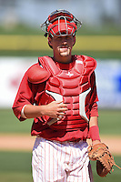 Clearwater Threshers catcher Logan Moore (10) during a game against the Tampa Yankees on April 9, 2014 at Bright House Field in Clearwater, Florida.  Tampa defeated Clearwater 5-3.  (Mike Janes/Four Seam Images)