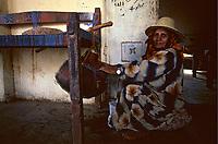 Yemen, wadi moor,grandmother cradles her grandchild