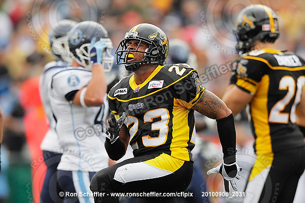 September 6, 2010; Hamilton, ON, CAN; Hamilton Tiger-Cats defensive back Will Heyward (23) celebrates a play. CFL football: Labour Day Classic - Toronto Argonauts vs. Hamilton Tiger-Cats at Ivor Wynne Stadium. The Tiger-Cats defeated the Argonauts 28-13. Mandatory Credit: Ron Scheffler.