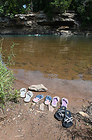 NWA Democrat-Gazette/J.T. WAMPLER Footwear is left on the shore as a family swims Monday July 8, 2019 at Riverside Park in West Fork. The White River flows through West Fork providing a convenient swimming hole. The National Weather Service is calling for high temperatures in the 90s this week.