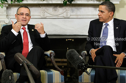 President Mauricio Funes (L) of El Salvador speaks as United States President Barack Obama (R) listens during their meeting in the Oval Office at the White House on Monday, March 8, 2010 in Washington, DC. Funes was the first Central American leader that Obama has met since he took office..Credit: Alex Wong - Pool via CNP