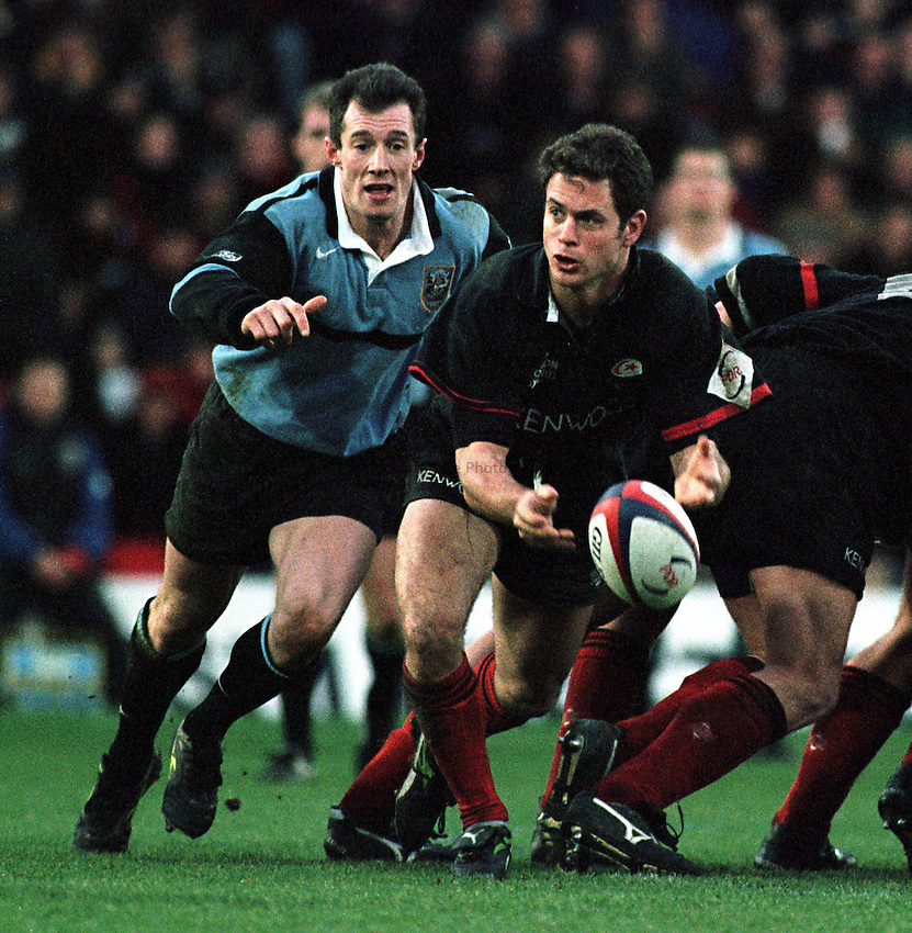 Photo. Richard Lane. .Saracens v Cardiff. 17/1/99..Kyran Bracken gets the ball away from the scrum under close scrutiny from Robert Howley..