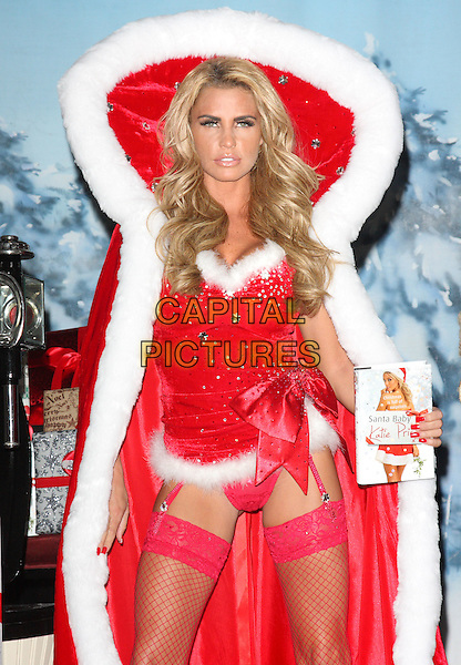 Katie Price (aka Jordan).'Santa Baby' photocall for her new book,  at Worx Studio, Parsons Green, London, England..2nd November 2011.half length red cape hood white fur trim  hold ups lace stocking fishnet lingerie ribbon bow velvet beads beaded knickers underwear .CAP/ROS.©Steve Ross/Capital Pictures