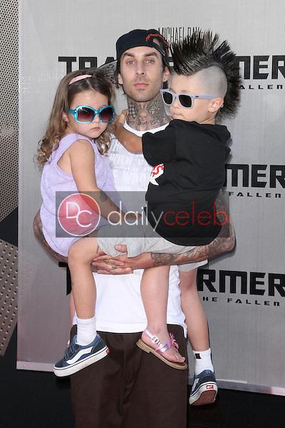 Travis Barker and family<br />at the Los Angeles Premiere of 'Transformers Revenge of the Fallen'. Mann Village Theatre, Westwood, CA. 06-22-09<br />Dave Edwards/DailyCeleb.com 818-249-4998