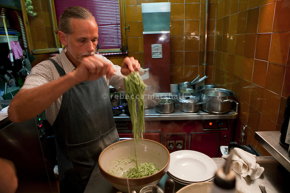 Chef Dominique le Stanc tosses fresh pasta 'au pistou' (pesto) before serving at his restaurant La Merenda, Nice, France, 16 October 2013.