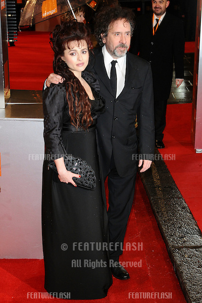 Helena Bonham Carter and director, Tim Burton arriving for the BAFTA Film Awards 2011 at the Royal Opera House Covent Garden, London. 13/02/2011  Picture by: Steve Vas / Featureflash