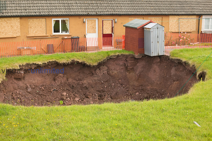 A massive hole in a back yard in Egremont, Cumbria, United Kingdom which opened as a result of mining subsidence after an old mine shaft collapsed
