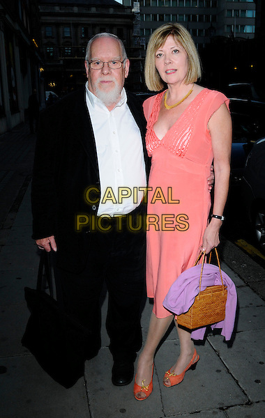 SIR PETER BAKE & wife.At the Stella McCartney Private Dinner, 5th Floor Restaurant, Harvey Nichols, Knightsbridge, London, England, .July 3rd 2008..full length coral peach orange dress .bag beard black suit white shirt .CAP/CAN.©Can Nguyen/Capital Pictures