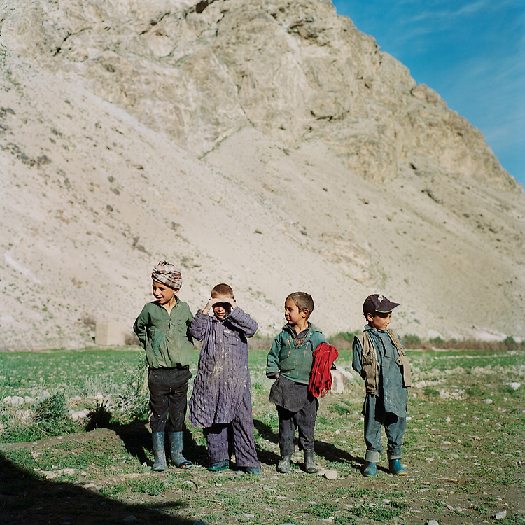 Boys take a break from playing in the village of Ghaz Khan.  Schooling has recently been made accessible in most villages, making this new generation the first to benefit from widespread education and stability.