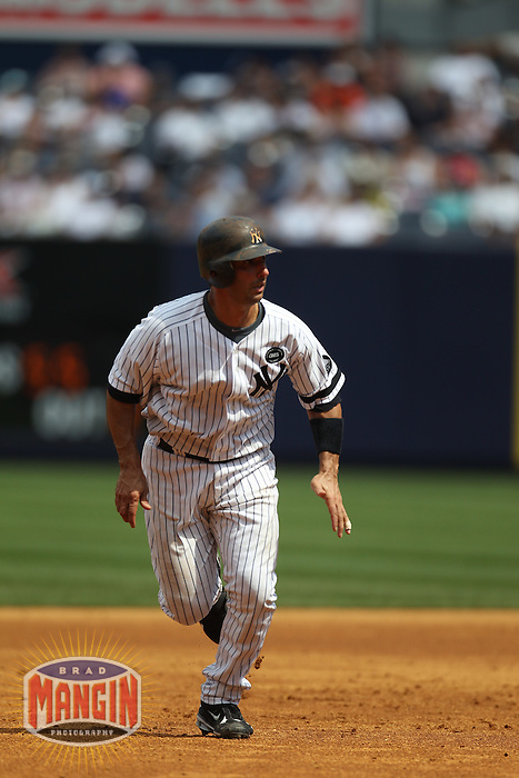 NEW YORK, NY - JULY 24:  Jorge Posada #20 of the New York Yankees runs the bases against the Kansas City Royals during the game at Yankee Stadium on July 24, 2010 in the Bronx borough of New York City. Photo by Brad Mangin