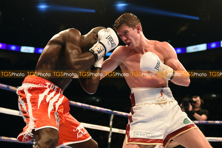 Yvan Mendy (red shorts) defeats Luke Campbell to win the WBC International Lightweight Title at the O2 Arena, London