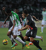 MEDELLIN - COLOMBIA -05-04-2014: Jefferson Duque (Izq.) jugador de Atletico Nacional disputa el balón con Andres Correa (Der.) jugador de Atletico Junior durante partido Atletico Nacional y Atletico Junior por la fecha 15 de la Liga Postobon I 2014 en el estadio Atanasio Girardot de la ciudad de Medellin. / Jefferson Duque (L) player of Atletico Nacional fights for the ball Andres Correa (R) player of Atletico Junior during a match Atletico Nacional and Atletico Junior for the date 15th of the Liga Postobon I 2014 at the Atanasio Girardot stadium in Medellin city. Photo: VizzorImage  / Luis Rios / Str.