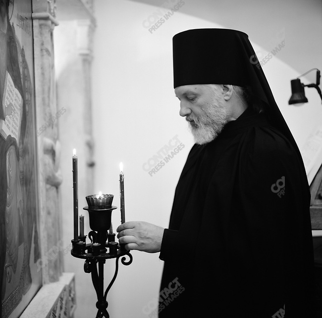 Father Yermagin, head of the farm of the Resurrection near Mikhailov, Ryazan region, at morning prayer. Russia, July 24, 2008.