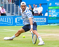 Feliciano Lopez (ESP) slides during the final against Marin Cillic (CRO), Aegon Tennis Championships Final, Queen's Tennis Club, London, England, 25th June 2017.