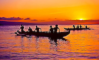 Outrigger paddlers take a break to watch the sunset off Ka'anapali Beach, Maui.