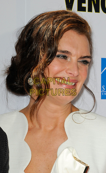 "BROOKE SHIELDS.The Los Angeles premiere of ""Furry Vengeance"" at Mann Bruin Theatre in Westwood, California, USA..April 18th, 2010 .headshot portrait hair up earrings silver white scallop edge edged wavy trim smiling.CAP/ROT.©Lee Roth/Capital Pictures"