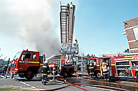 Firefighters attend a large factory fire. They use a Hydraulic Platform to aim the water directly onto the factory unit Oxfordshire UK. This image may only be used to portray the subject in a positive manner..©shoutpictures.com..john@shoutpictures.com