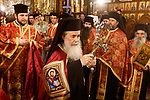 Jerusalem's Greek Orthodox patriarch Theophilos III attends a Christmas service according to the Eastern Orthodox calendar, in the church of Nativity in the West Bank town of Bethlehem on January 6, 2018. The municipalities of Bethlehem, Beit Sahour and Beit Jala, all in the Israeli-occupied West Bank, called for the boycott over Jerusalem's Greek Orthodox patriarch allegedly allowing controversial real estate sales. Photo by Wisam Hashlamoun