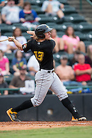 Michael Suchy (13) of the West Virginia Power follows through on his swing against the Hickory Crawdads at L.P. Frans Stadium on August 15, 2015 in Hickory, North Carolina.  The Power defeated the Crawdads 9-0.  (Brian Westerholt/Four Seam Images)