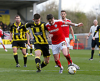 Burton Albion v Barnsley 16.4.16 .Sky Bet League 1 ....... Burtons Calum Butcher with Barnsleys Adam Hammill