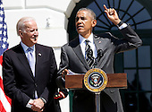 United States President Barack Obama (R) speaks during the Wounded Warrior Ride event while Vice President Joe Biden (L) listens at the White House, in Washington, DC, April 14, 2016.  The event helps raise awareness to the public about severely injured veterans and provides rehabilitation opportunities. <br /> Credit: Aude Guerrucci / Pool via CNP