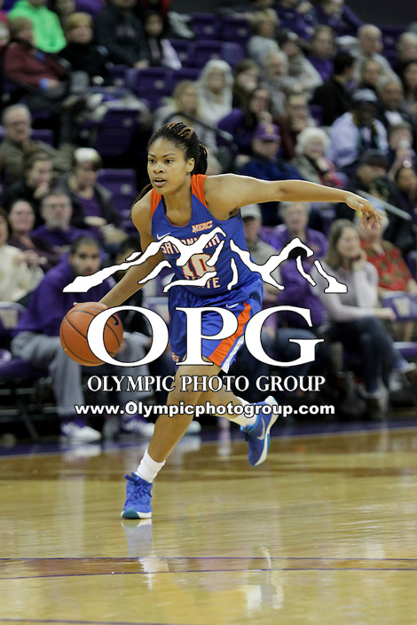 SEATTLE, WA - DECEMBER 18: Savannah State's #20 Lauren Moss brings the ball down court against Washington.  Washington won 87-36 over Savannah State at Alaska Airlines Arena in Seattle, WA.