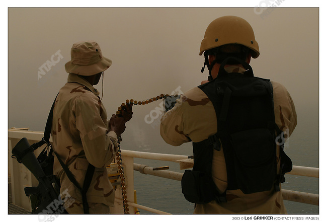 "Marine guards during target practice on the ""bridge."" USNS COMFORT Naval hospital ship in the Persian Gulf."