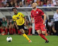 NASHVILLE, TN - JULY 3: Michael Bradley #4 and Peter Vassell #16 go for the ball during a game between Jamaica and USMNT at Nissan Stadium on July 3, 2019 in Nashville, Tennessee.