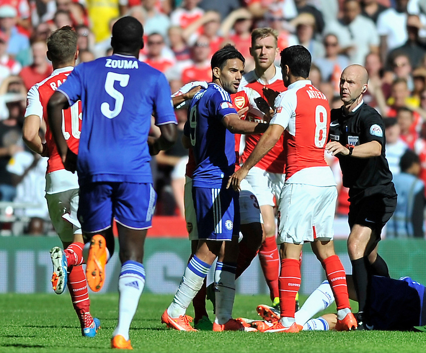 Arsenal's Mikel Arteta (8) angered by Chelsea's Radamel Falcao Garcia<br /> <br /> Photographer Ashley Western/CameraSport<br /> <br /> Football - FA Community Shield - Arsenal v Chelsea - Sunday 2nd August 2015 - Wembley Stadium - London<br /> <br /> &copy; CameraSport - 43 Linden Ave. Countesthorpe. Leicester. England. LE8 5PG - Tel: +44 (0) 116 277 4147 - admin@camerasport.com - www.camerasport.com