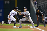Ryan McBroom (6) of the Scranton/Wilkes-Barre RailRiders waits for a pick-off throw as Ramon Torres (12) of the Charlotte Knights heads back to first base at BB&T BallPark on August 14, 2019 in Charlotte, North Carolina. The Knights defeated the RailRiders 13-12 in ten innings. (Brian Westerholt/Four Seam Images)