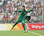 13 August 2008: Victor Obinna (NGA) (9) and Robbie Rogers (USA) (14) challenge for a header.  The men's Olympic team of Nigeria defeated the men's Olympic soccer team of the United States 2-1 at Beijing Workers' Stadium in Beijing, China in a Group B round-robin match in the Men's Olympic Football competition.
