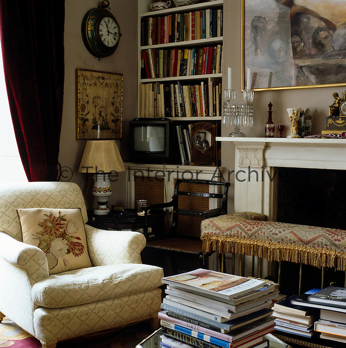 A well-used corner of the living room is filled with favourite books and objects