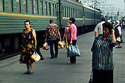 Street vendors selling melons and other goods wait for vacationers at the railway station of Melitopol. All the trains pass through it on their way to the Azov sea and the Black sea. Ukraine. Melitopol. 08.2009. Oksana Yushko for Mare