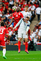 Alfred Effiong of Malta (19) beats Wayne Rooney (Manchester United) of England in the air during the FIFA World Cup qualifying match between England and Malta at Wembley Stadium, London, England on 8 October 2016. Photo by David Horn / PRiME Media Images.