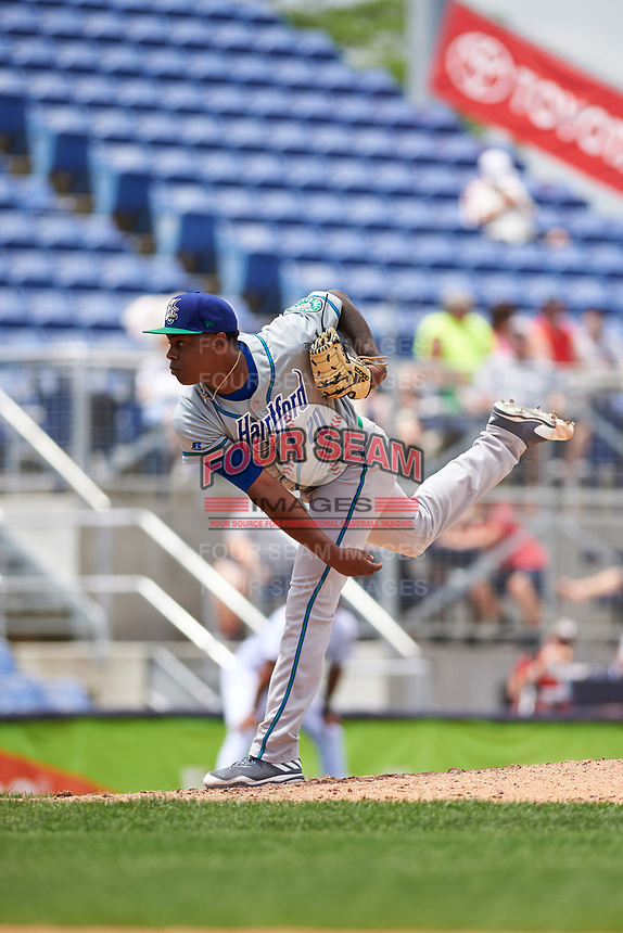 Hartford Yard Goats starting pitcher Yency Almonte (20) follows through on a pitch during a game against the Binghamton Rumble Ponies on July 9, 2017 at NYSEG Stadium in Binghamton, New York.  Hartford defeated Binghamton 7-3.  (Mike Janes/Four Seam Images)