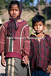 Children of laborers holding hands in Uttar Pradesh, Northern India.