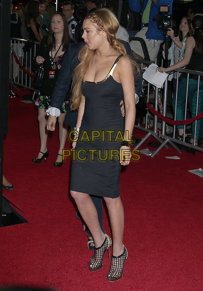"Lindsay Lohan.Attending the ""Scary Movie 5"" Los Angeles film premiere held at the Cinerama Dome, Hollywood, California, USA,.11th April 2013..full length swollen puffy face lips swollen dress black cleavage plaits hair braids platform tanned fake tan necklace cross trim straps gold bracelets fishnet shoes cut out ankle boots shooboots heels side .CAP/ADM/RE.©Russ Elliot/AdMedia/Capital Pictures"
