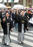 March 27, 2013, Tokyo, Japan - Ichikawa Chusha, left, and Nakamura Kankuro wave to fans as some 60 leading Kabuki actors parade in the rain through the main street of Tokyo's Ginza shopping district on Wednesday, March 27, 2013, in celebration of the grand opening of new Kabuki theater. After three years of renovation, the majestic theater for Japan's centuries-old performing arts of Kabuki will open its doors to the public with a three-month series of most sought-after plays.  (Photo by Natsuki Sakai/AFLO)