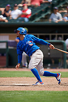 Iowa Cubs shortstop Ozzie Martinez (28) follows through on a swing during a game against the Memphis Redbirds on May 29, 2017 at AutoZone Park in Memphis, Tennessee.  Memphis defeated Iowa 6-5.  (Mike Janes/Four Seam Images)